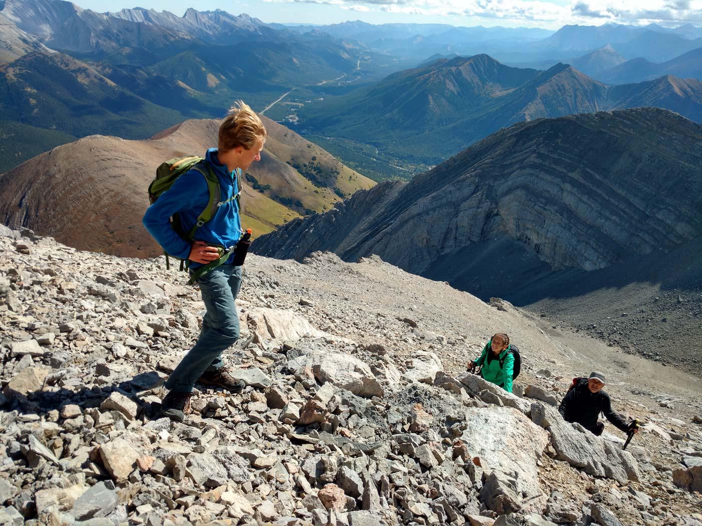 Adam, Anna and Mark Kucharski hiking up Mist Mountain in Kananaskis Country, Alberta, Calgary.