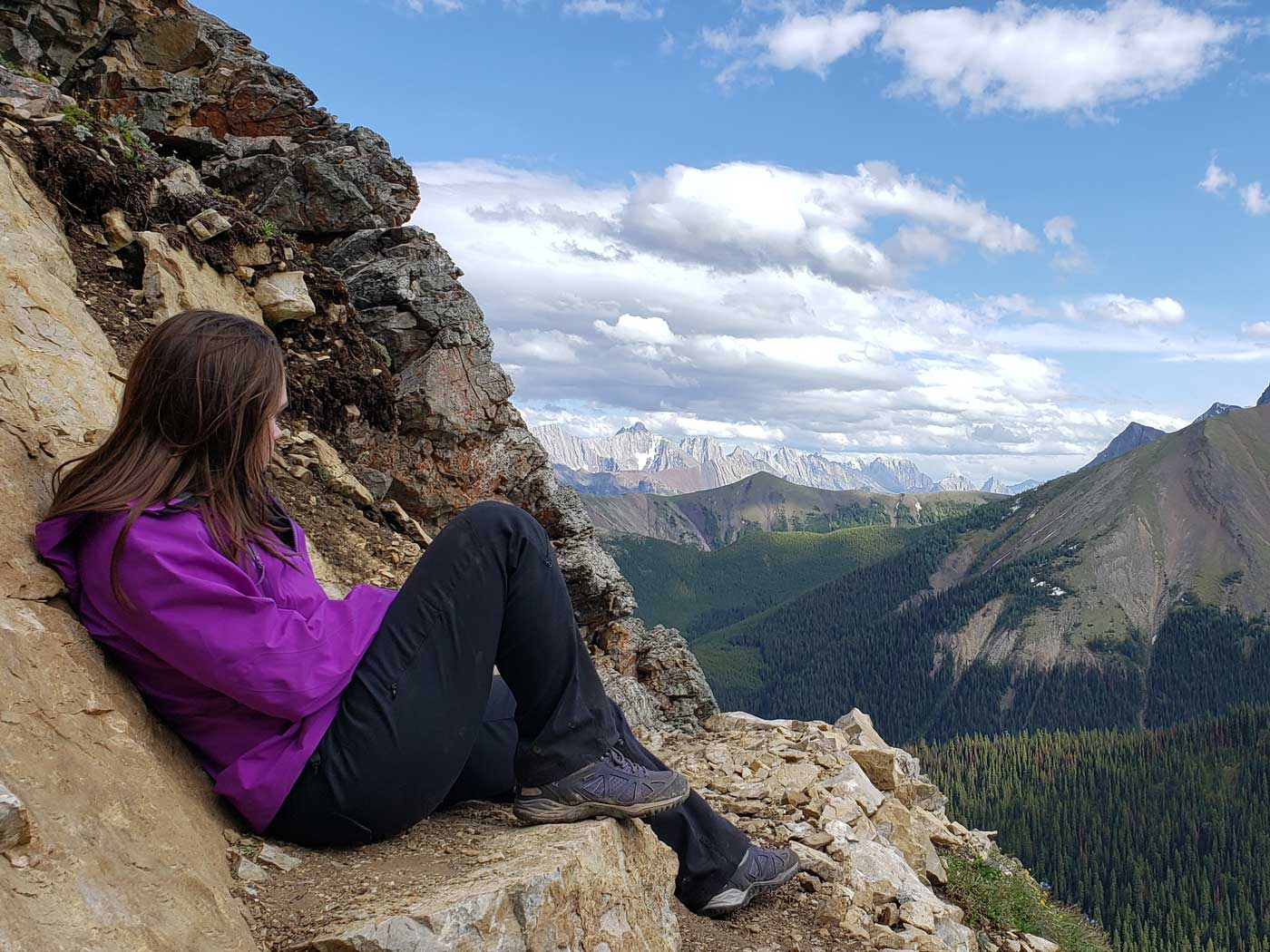 Jolene Rempel looking at mountains from Guinn's Pass Trail in Kananaskis Country, Alberta, Canada.