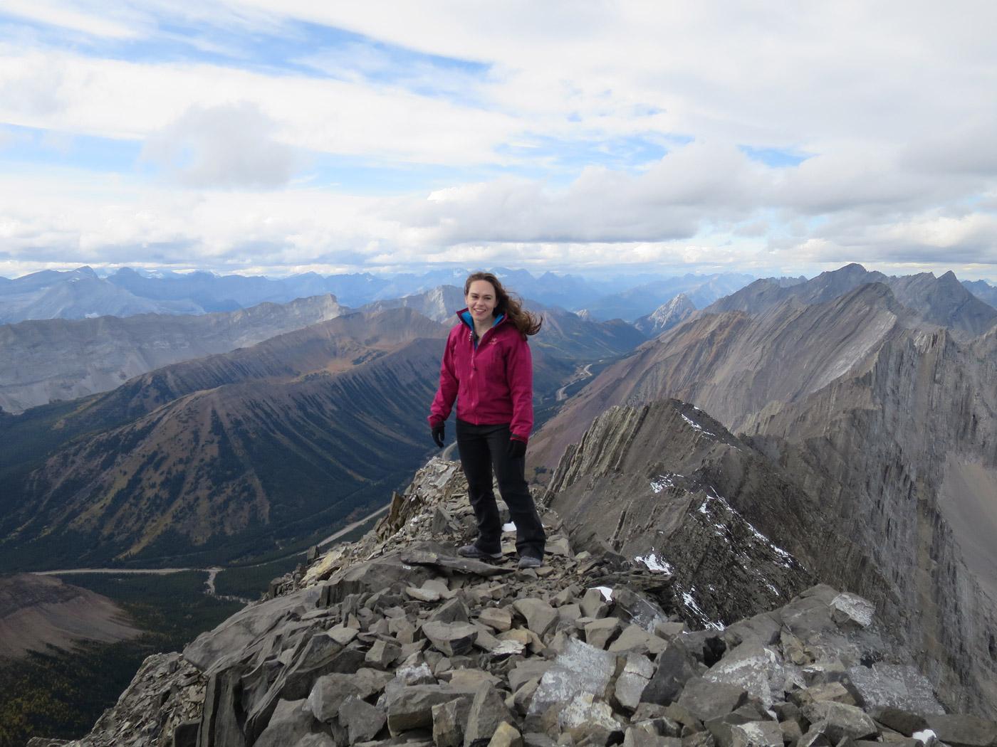 Jolene Rempel on summit of Mist Mountain in Kananaskis Country, Alberta, Canada.