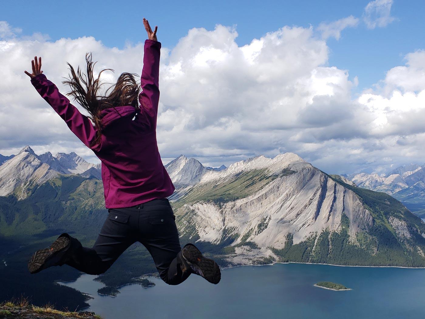 Jolene Rempel jumping on Sarrail Ridge in Kananaskis Country, Alberta, Canada.